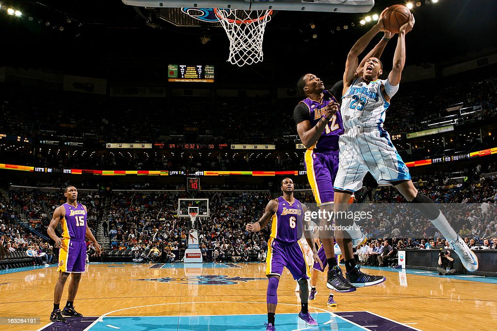 Anthony Davis #23 of the New Orleans Hornets drives to the basket against <a gi-track='captionPersonalityLinkClicked' href=/galleries/search?phrase=Dwight+Howard&family=editorial&specificpeople=201570 ng-click='$event.stopPropagation()'>Dwight Howard</a> #12 of the Los Angeles Lakers on March 6, 2013 at the New Orleans Arena in New Orleans, Louisiana.