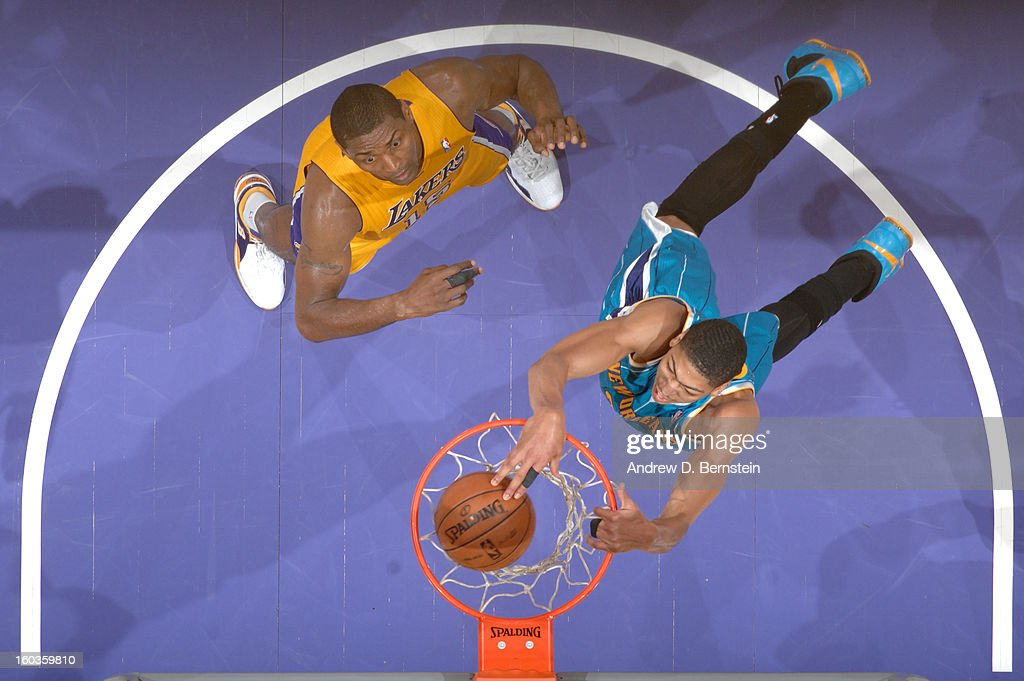 Anthony Davis #23 of the New Orleans Hornets dunks against Metta World Peace #15 of the Los Angeles Lakers at Staples Center on January 29, 2013 in Los Angeles, California.
