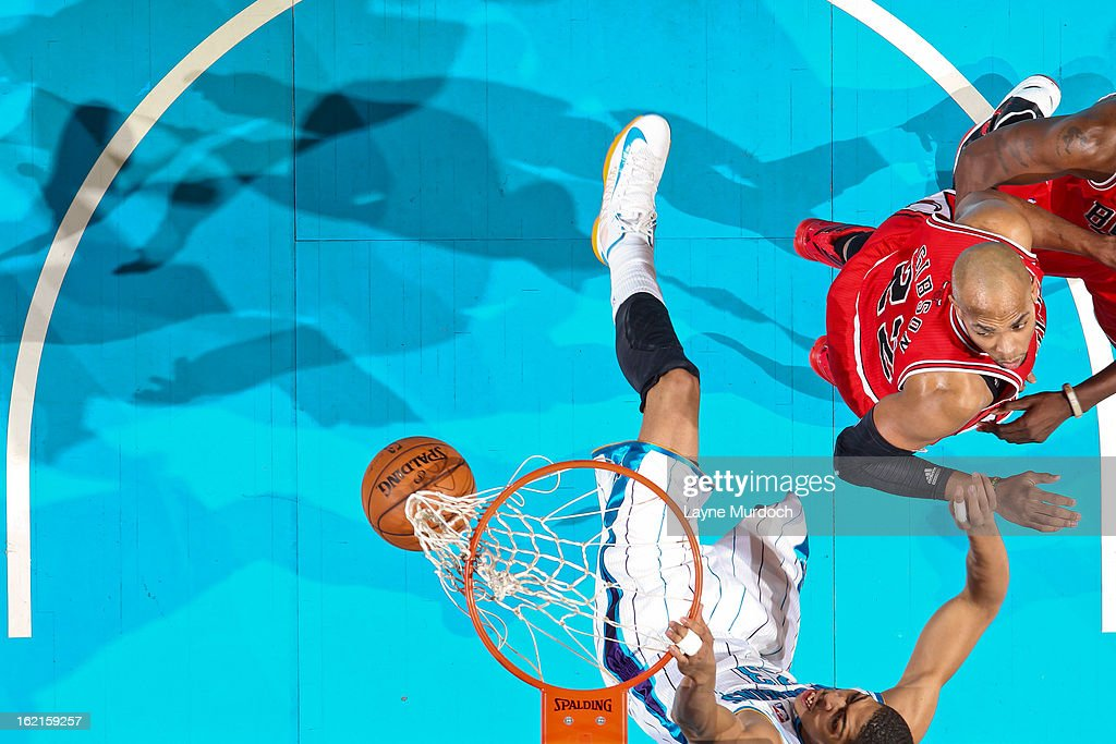 Anthony Davis #23 of the New Orleans Hornets dunks against <a gi-track='captionPersonalityLinkClicked' href=/galleries/search?phrase=Taj+Gibson&family=editorial&specificpeople=4029461 ng-click='$event.stopPropagation()'>Taj Gibson</a> #22 of the Chicago Bulls on February 19, 2013 at the New Orleans Arena in New Orleans, Louisiana.