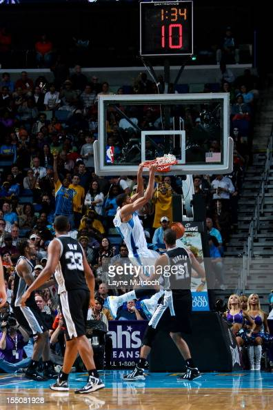 Anthony Davis of the New Orleans Hornets dunks against Tim Duncan of the San Antonio Spurs on October 31 2012 at the New Orleans Arena in New Orleans...