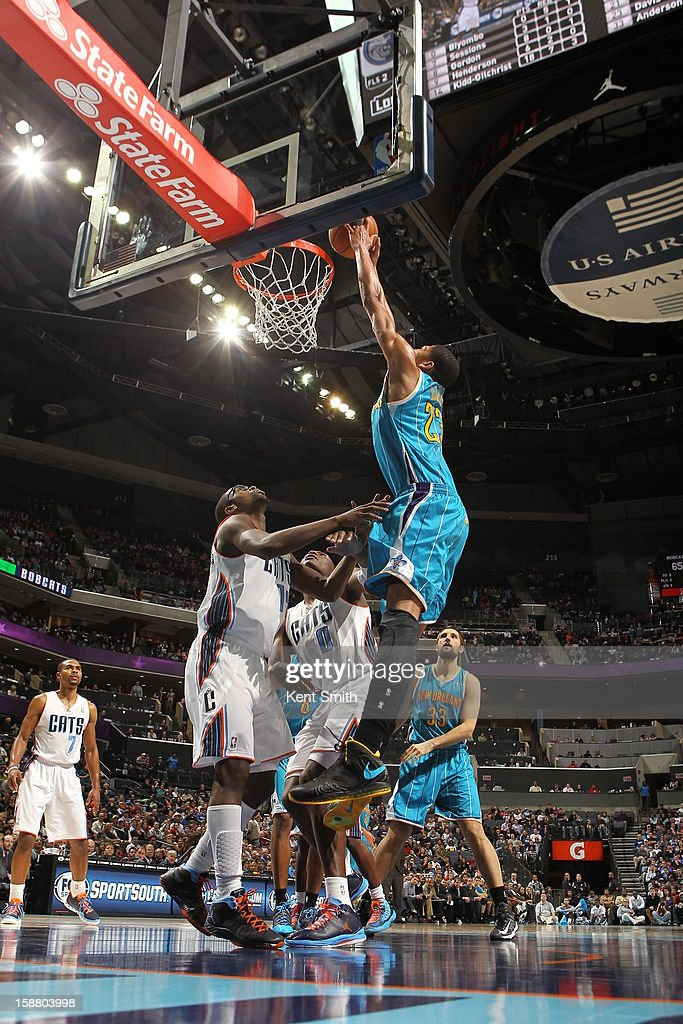 Anthony Davis #23 of the New Orleans Hornets dunks over <a gi-track='captionPersonalityLinkClicked' href=/galleries/search?phrase=Michael+Kidd-Gilchrist&family=editorial&specificpeople=8526214 ng-click='$event.stopPropagation()'>Michael Kidd-Gilchrist</a> #14 of the Charlotte Bobcats at the Time Warner Cable Arena on December 29, 2012 in Charlotte, North Carolina.