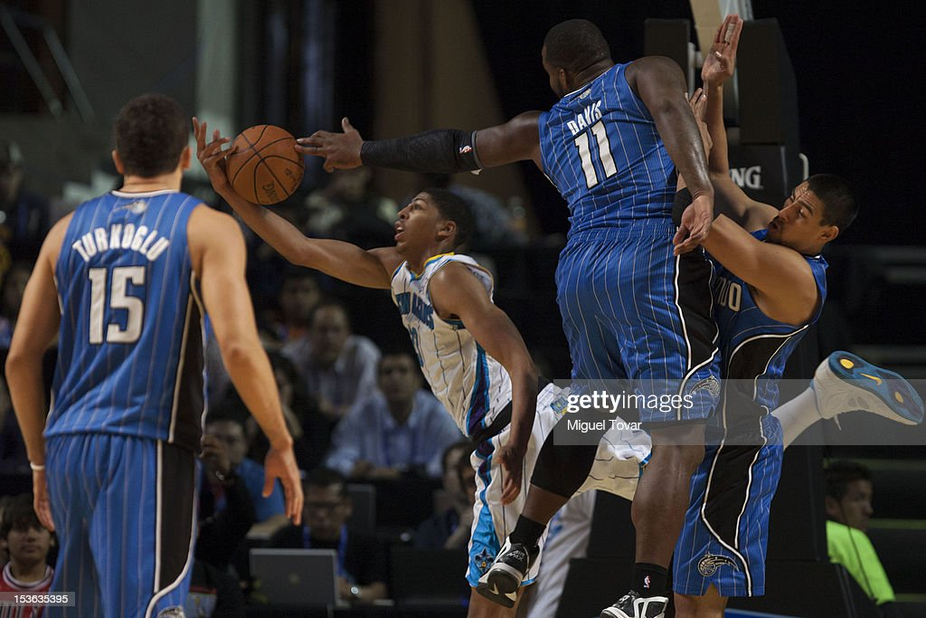 Anthony Davis #15 of the New Orleans Hornets fights for the ball with <a gi-track='captionPersonalityLinkClicked' href=/galleries/search?phrase=Glen+Davis+-+Basketball+Player&family=editorial&specificpeople=709385 ng-click='$event.stopPropagation()'>Glen Davis</a> #11 of the Orlando Magic, during the game between the Orlando Magic and the New Orleans Hornets on October 7, 2012 at Mexico City Arena in Mexico City.