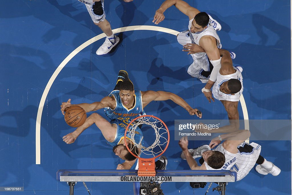 Anthony Davis #23 of the New Orleans Hornets goes up for the slamdunk in traffic against the Orlando Magic during the game on December 26, 2012 at Amway Center in Orlando, Florida.