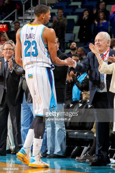 Anthony Davis of the New Orleans Hornets greets the team's owner Tom Benson following a victory against the San Antonio Spurs on January 7 2013 at...