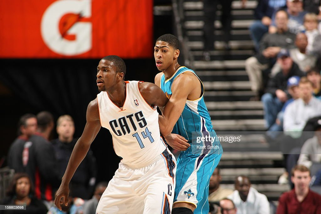 Anthony Davis #23 of the New Orleans Hornets guards his fellow teammate in college Michael Kidd-Gilchrist #14 of the Charlotte Bobcats during the game at the Time Warner Cable Arena on December 29, 2012 in Charlotte, North Carolina.