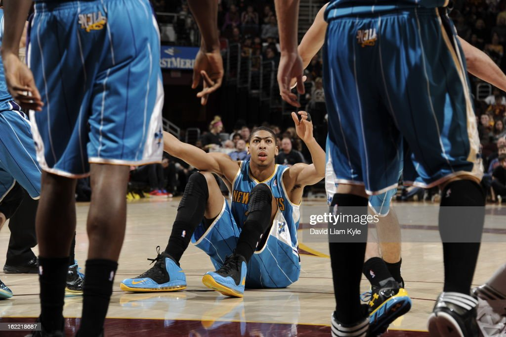 Anthony Davis #23 of the New Orleans Hornets is helped up by teammates during a break in the action against the Cleveland Cavaliers at The Quicken Loans Arena on February 20, 2013 in Cleveland, Ohio.