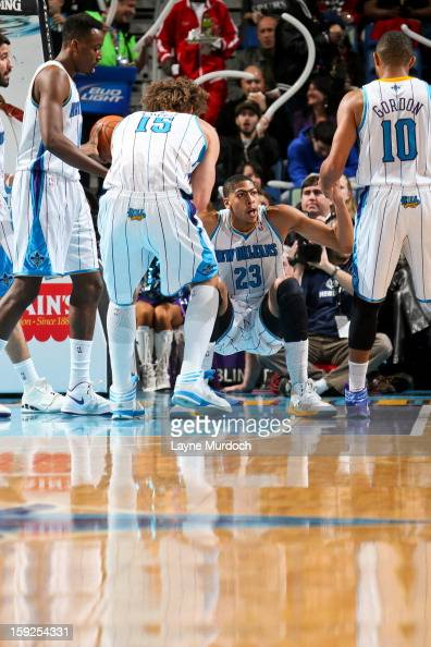 Anthony Davis of the New Orleans Hornets is helped up by teammates Eric Gordon and Robin Lopez against the San Antonio Spurs on January 7 2013 at the...
