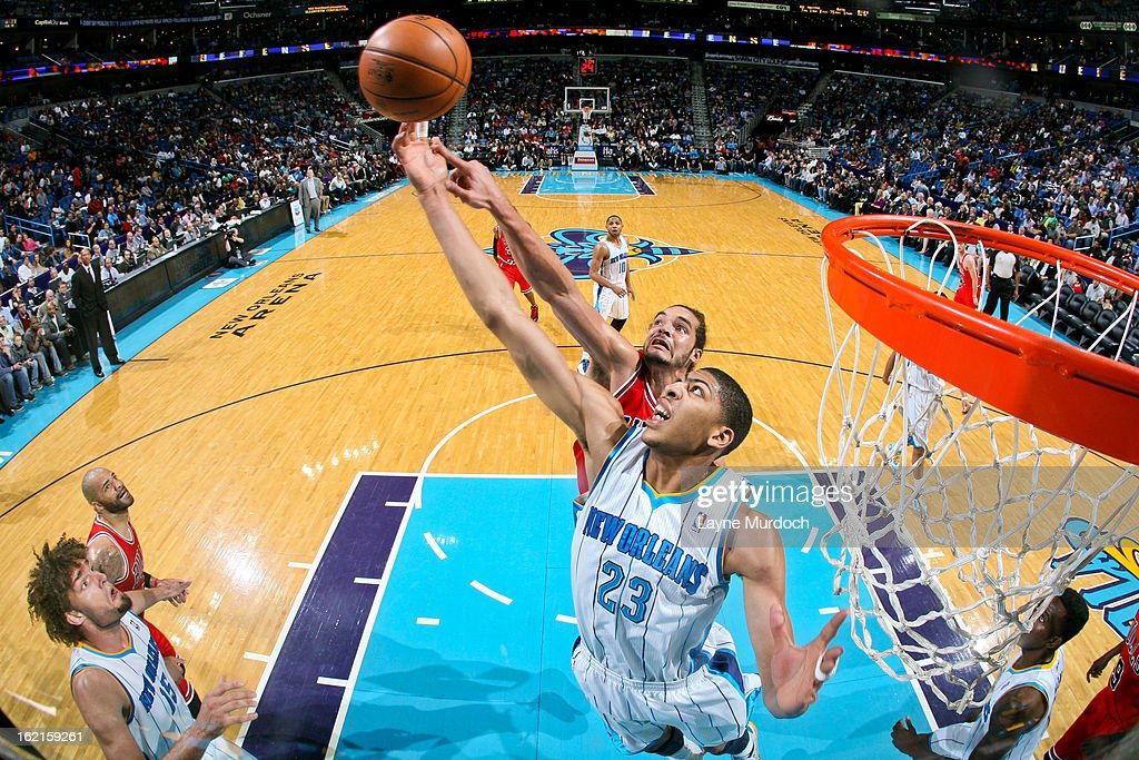 Anthony Davis #23 of the New Orleans Hornets reaches for a rebound against <a gi-track='captionPersonalityLinkClicked' href=/galleries/search?phrase=Joakim+Noah&family=editorial&specificpeople=699038 ng-click='$event.stopPropagation()'>Joakim Noah</a> #13 of the Chicago Bulls on February 19, 2013 at the New Orleans Arena in New Orleans, Louisiana.