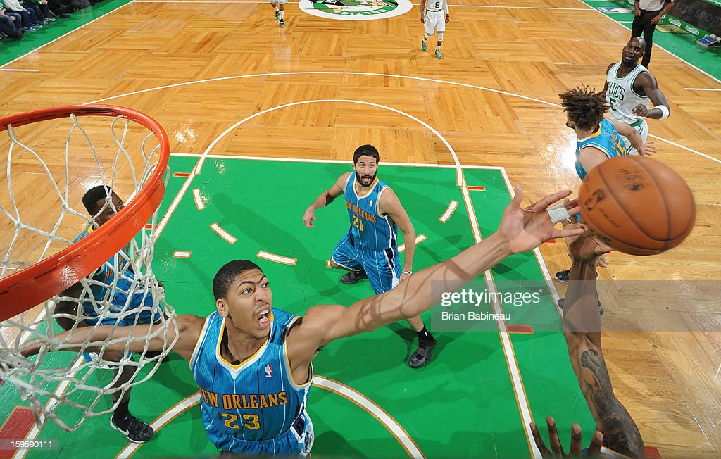 Anthony Davis #23 of the New Orleans Hornets reaches for the ball against the Boston Celtics on January 16, 2013 at the TD Garden in Boston, Massachusetts.