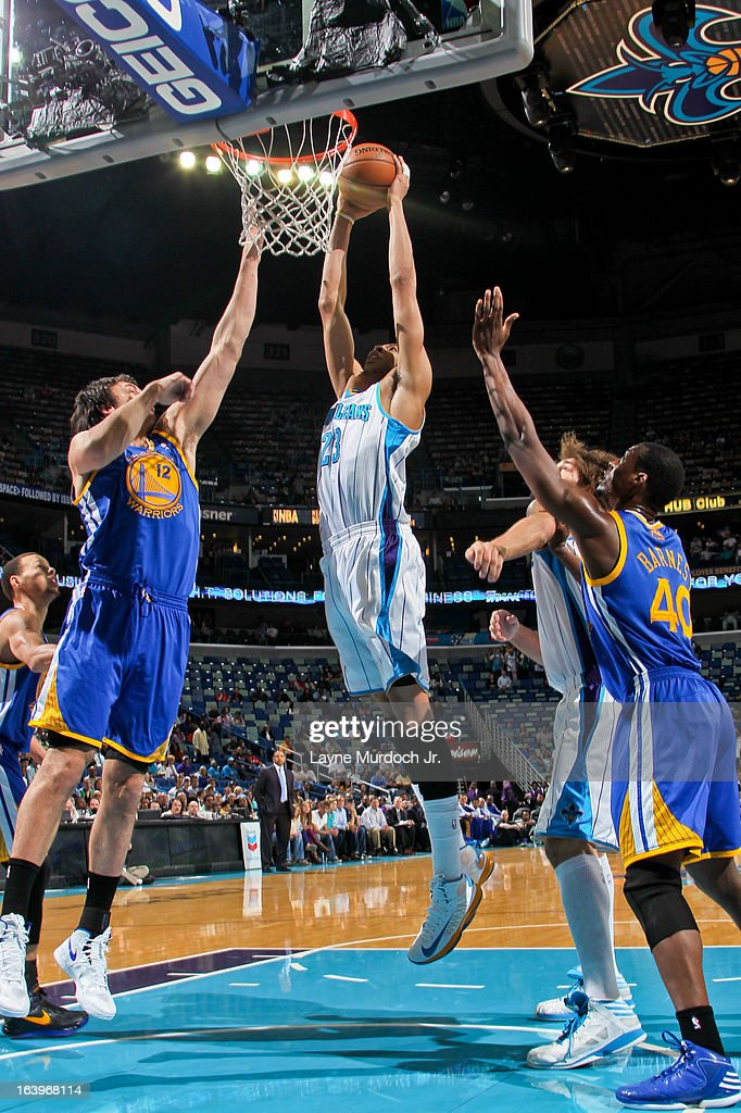 Anthony Davis #23 of the New Orleans Hornets rises for a dunk against Andrew Bogut #12 of the Golden State Warriors on March 18, 2013 at the New Orleans Arena in New Orleans, Louisiana.