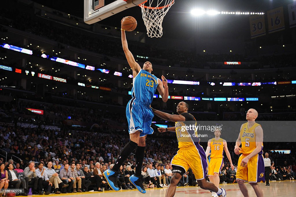 Anthony Davis #23 of the New Orleans Hornets rises for a dunk against Dwight Howard #12 of the Los Angeles Lakers at Staples Center on April 9, 2013 in Los Angeles, California.