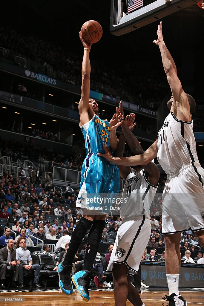 Anthony Davis #23 of the New Orleans Hornets shoots against <a gi-track='captionPersonalityLinkClicked' href=/galleries/search?phrase=Andray+Blatche&family=editorial&specificpeople=4282797 ng-click='$event.stopPropagation()'>Andray Blatche</a> #0 and Brook Lopez #11 of the Brooklyn Nets on March 12, 2013 at the Barclays Center in the Brooklyn borough of New York City.