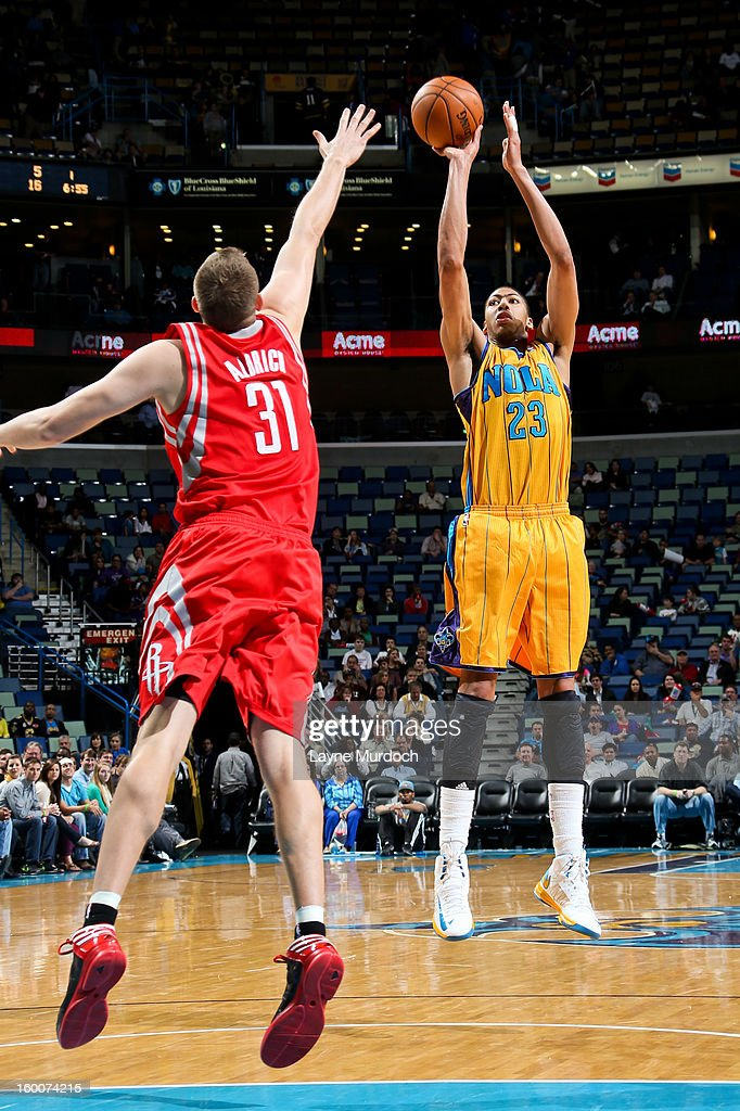 Anthony Davis #23 of the New Orleans Hornets shoots against <a gi-track='captionPersonalityLinkClicked' href=/galleries/search?phrase=Cole+Aldrich&family=editorial&specificpeople=4226189 ng-click='$event.stopPropagation()'>Cole Aldrich</a> #31 of the Houston Rockets on January 25, 2013 at the New Orleans Arena in New Orleans, Louisiana.