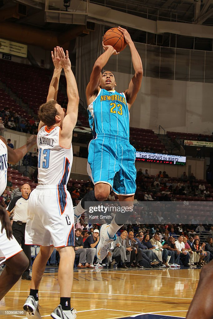 Anthony Davis #23 of the New Orleans Hornets shoots against <a gi-track='captionPersonalityLinkClicked' href=/galleries/search?phrase=Matt+Carroll+-+Basketball+Player&family=editorial&specificpeople=213200 ng-click='$event.stopPropagation()'>Matt Carroll</a> #13 of the Charlotte Bobcats at the North Charleston Coliseum on October 11, 2012 in North Charleston, South Carolina.