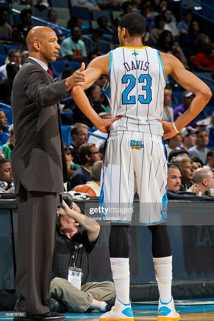 Anthony Davis #23 of the New Orleans Hornets speaks with head coach Monty Williams during a game against the Golden State Warriors on March 18, 2013 at the New Orleans Arena in New Orleans, Louisiana.