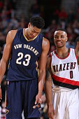Anthony Davis of the New Orleans Pelicans and Damian Lillard of the Portland Trail Blazers speak during a game on November 17 2014 at the Moda Center...