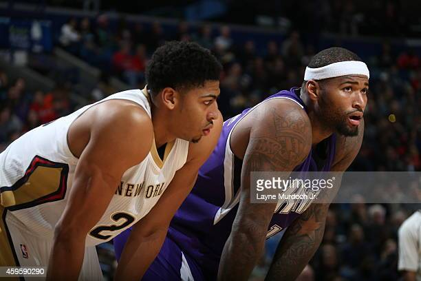 Anthony Davis of the New Orleans Pelicans and DeMarcus Cousins of the Sacramento Kings look on during the game on November 25 2014 at the Smoothie...