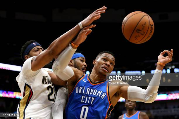 Anthony Davis of the New Orleans Pelicans and Russell Westbrook of the Oklahoma City Thunder scramble for a rebound during a NBA game at the Smoothie...