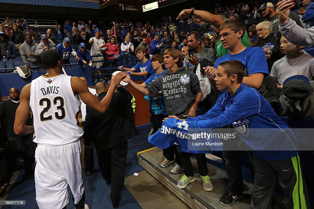 Anthony Davis #23 of the New Orleans Pelicans and University of Kentucky player high fives fans as he leaves the court after defeating the Washington Wizards 93-89 during an NBA game on October 19, 2013 at Rupp Arena in Lexington, Kentucky.
