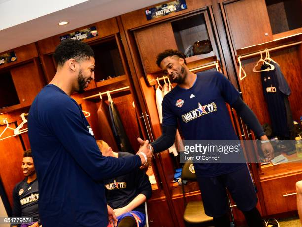 Anthony Davis of the New Orleans Pelicans and Wesley Matthews of the Dallas Mavericks shake hands in the locker room before State Farm AllStar...