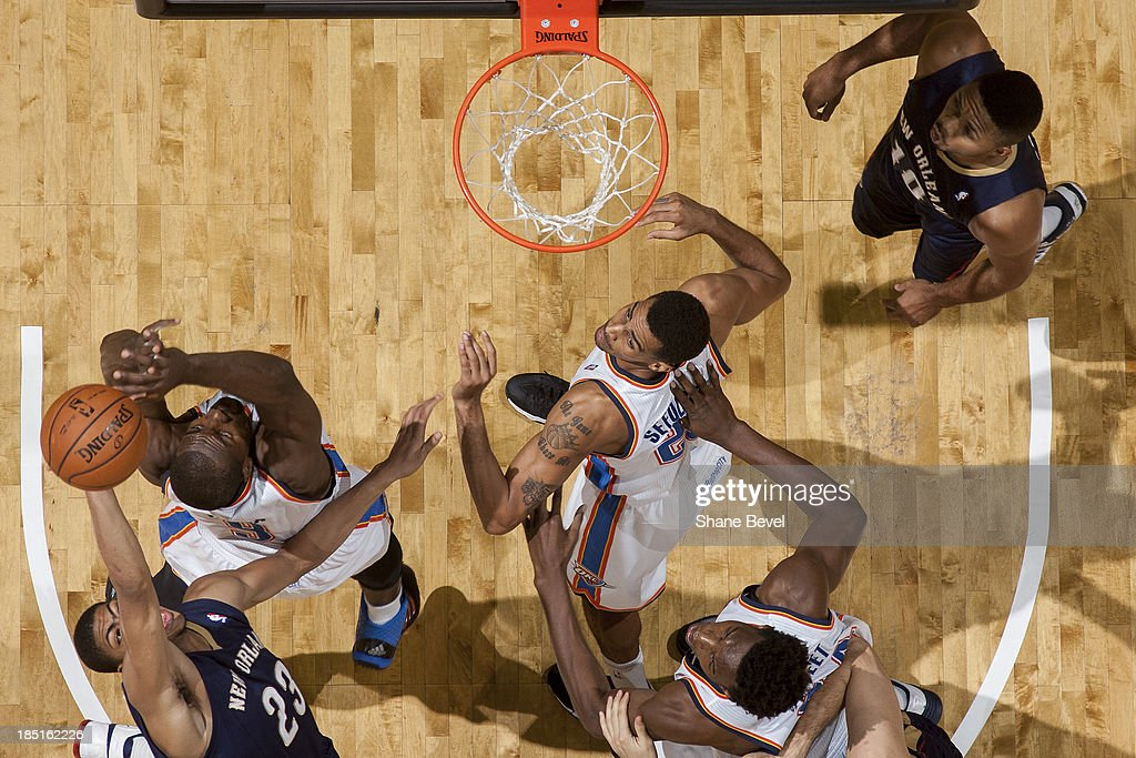 Anthony Davis #23 of the New Orleans Pelicans battles for a rebound with <a gi-track='captionPersonalityLinkClicked' href=/galleries/search?phrase=Serge+Ibaka&family=editorial&specificpeople=5133378 ng-click='$event.stopPropagation()'>Serge Ibaka</a> #9 of the Oklahoma City Thunder during the NBA preseason game on October 17, 2013 at the BOK Center in Tulsa, Oklahoma.