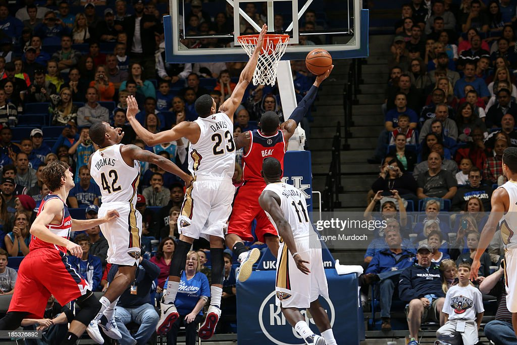 Anthony Davis #23 of the New Orleans Pelicans blocks the game tying basket by <a gi-track='captionPersonalityLinkClicked' href=/galleries/search?phrase=Bradley+Beal&family=editorial&specificpeople=7640439 ng-click='$event.stopPropagation()'>Bradley Beal</a> #3 of the Washington Wizards during the last seconds of an NBA game on October 19, 2013 at Rupp Arena in Lexington, Kentucky.