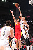 Anthony Davis of the New Orleans Pelicans blocks the shot of Donatas Motiejunas of the Houston Rockets on December 18 2014 at the Toyota Center in...