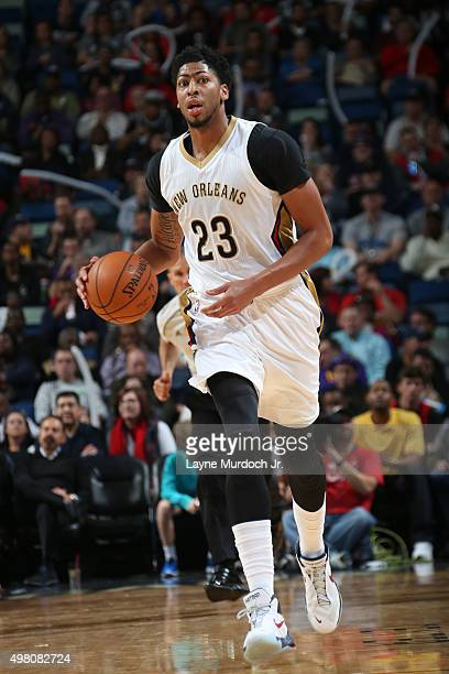 Anthony Davis of the New Orleans Pelicans brings the ball up court against the San Antonio Spurs on November 20 2015 at the Smoothie King Center in...