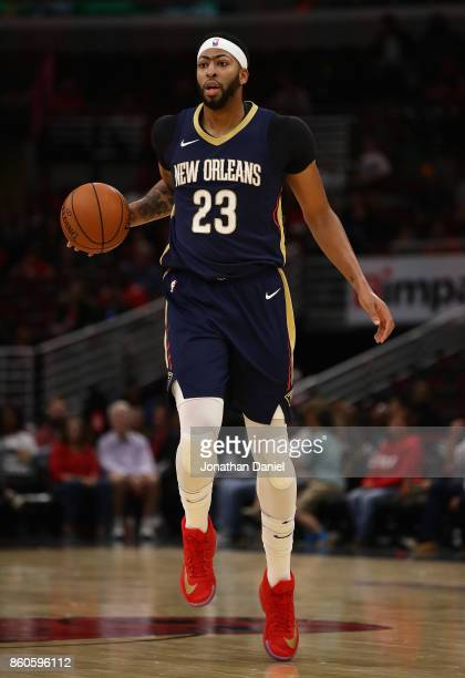 Anthony Davis of the New Orleans Pelicans brings the ball up the court against the Chicago Bulls during a preseason game at the United Center on...