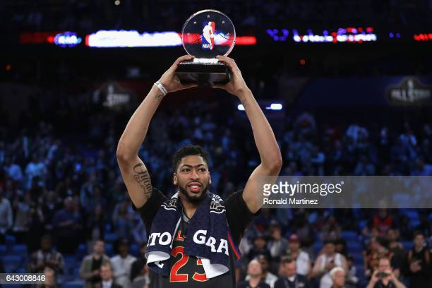 Anthony Davis of the New Orleans Pelicans celebrates with the 2017 NBA AllStar Game MVP trophy after the 2017 NBA AllStar Game at Smoothie King...