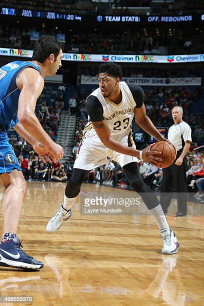 Anthony Davis of the New Orleans Pelicans defends the ball against the Dallas Mavericks during the game on November 10 2015 at Smoothie King Center...