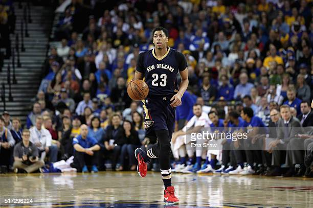 Anthony Davis of the New Orleans Pelicans dribbles against the Golden State Warriors at ORACLE Arena on March 14 2016 in Oakland California NOTE TO...