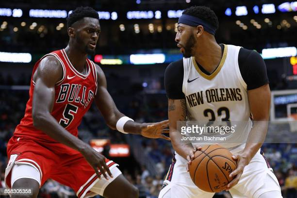 Anthony Davis of the New Orleans Pelicans drives against Bobby Portis of the Chicago Bulls during a preseason game at the Smoothie King Center on...