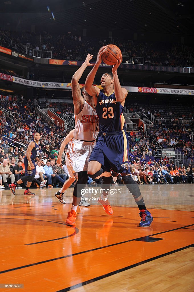 Anthony Davis #23 of the New Orleans Pelicans drives against <a gi-track='captionPersonalityLinkClicked' href=/galleries/search?phrase=Markieff+Morris&family=editorial&specificpeople=5293881 ng-click='$event.stopPropagation()'>Markieff Morris</a> #11 of the Phoenix Suns on November 10, 2013 at U.S. Airways Center in Phoenix, Arizona.