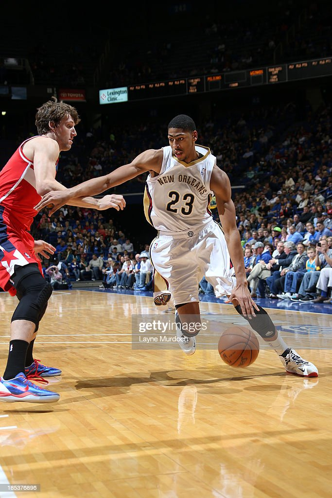 Anthony Davis #23 of the New Orleans Pelicans drives on <a gi-track='captionPersonalityLinkClicked' href=/galleries/search?phrase=Jan+Vesely&family=editorial&specificpeople=5620499 ng-click='$event.stopPropagation()'>Jan Vesely</a> #24 of the Washington Wizards during an NBA game on October 19, 2013 at Rupp Arena in Lexington, Kentucky.