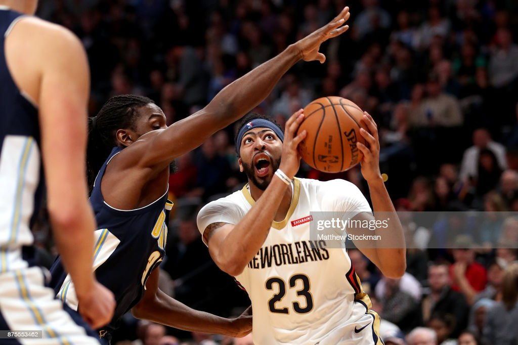 Anthony Davis #23 of the New Orleans Pelicans drives to the basket against Kenneth Faried #35 of the Denver Nuggets at the Pepsi Center on November 17, 2017 in Denver, Colorado.