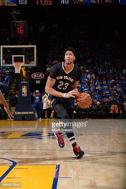 Anthony Davis of the New Orleans Pelicans drives to the basket against the Golden State Warriors on October 27 2015 at Oracle Arena in Oakland...