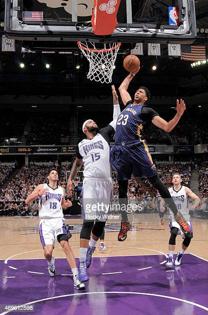 Anthony Davis of the New Orleans Pelicans dunks against DeMarcus Cousins of the Sacramento Kings on April 3 2015 at Sleep Train Arena in Sacramento...