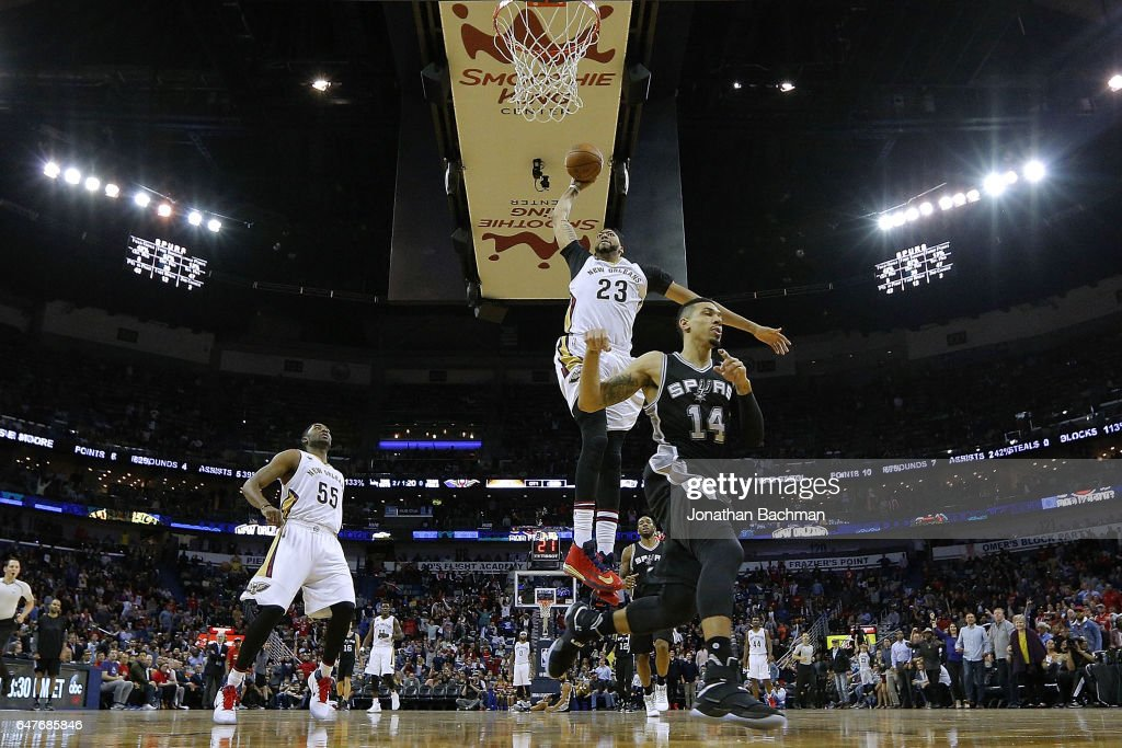 Anthony Davis #23 of the New Orleans Pelicans dunks the ball against Danny Green #14 of the San Antonio Spurs during the second half of a game at the Smoothie King Center on March 3, 2017 in New Orleans, Louisiana.