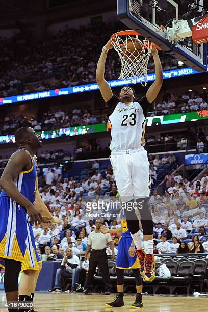 Anthony Davis of the New Orleans Pelicans dunks the ball during Game Four of the Western Conference Quarterfinals against the Golden State Warriors...