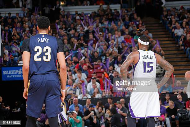 Anthony Davis of the New Orleans Pelicans faces off against DeMarcus Cousins of the Sacramento Kings on March 16 2016 at Sleep Train Arena in...