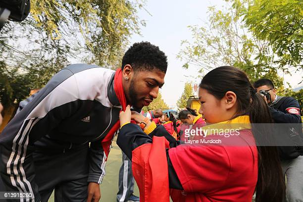 Anthony Davis of the New Orleans Pelicans gets a scarf during the NBA Cares Learn and Play Center Dedication part of the 2016 Global Games China at...