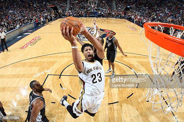 Anthony Davis of the New Orleans Pelicans goes to the basket against the San Antonio Spurs on November 20 2015 at the Smoothie King Center in New...