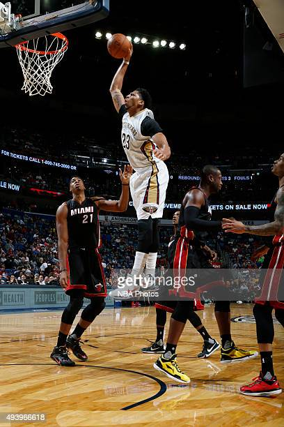 Anthony Davis of the New Orleans Pelicans goes up for a dunk against the Miami Heat during a preseason game on October 23 2015 at the Smoothie King...