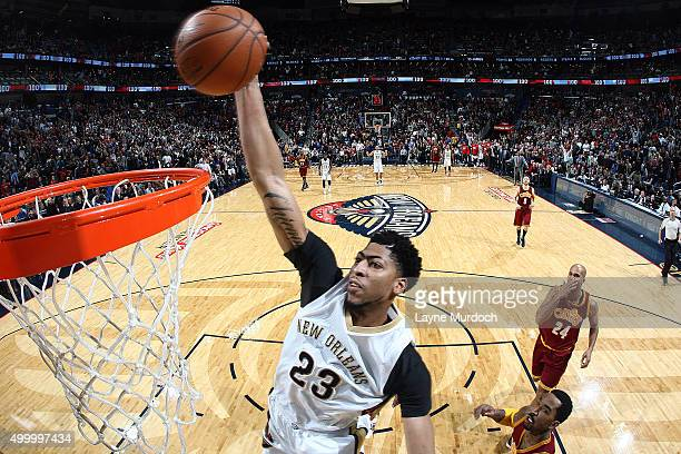 Anthony Davis of the New Orleans Pelicans goes up for a dunk against the Cleveland Cavaliers on December 4 2015 at Smoothie King Center in New...
