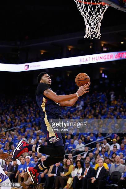 Anthony Davis of the New Orleans Pelicans goes up for a shot against the Golden State Warriors during the NBA season opener at ORACLE Arena on...