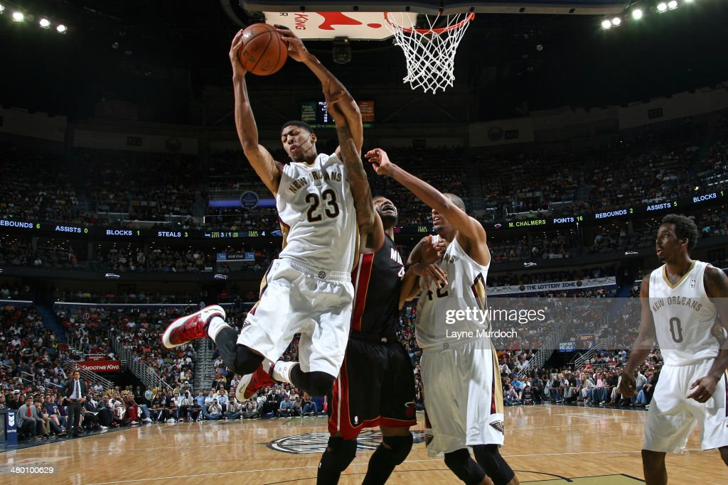 Anthony Davis #23 of the New Orleans Pelicans grabs a rebound against the Miami Heat on March 22, 2014 at the Smoothie King Center in New Orleans, Louisiana.