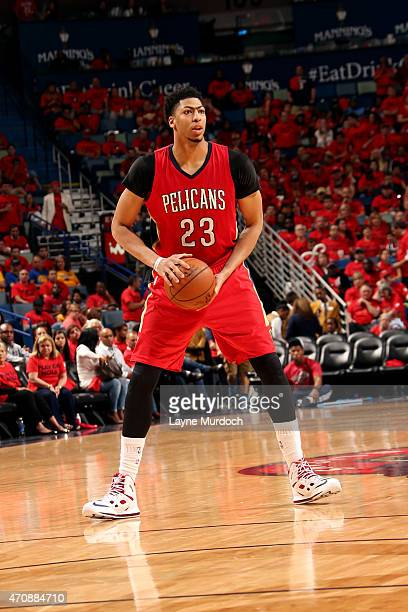 Anthony Davis of the New Orleans Pelicans handles the ball against the Golden State Warriors in Game Three of the Western Conference Quarterfinals...