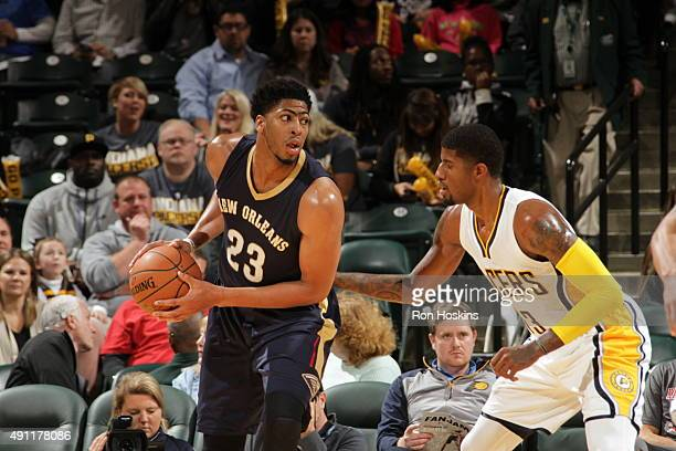 Anthony Davis of the New Orleans Pelicans handles the ball against Paul George of the Indiana Pacers during a preseason game on October 3 2015 at...