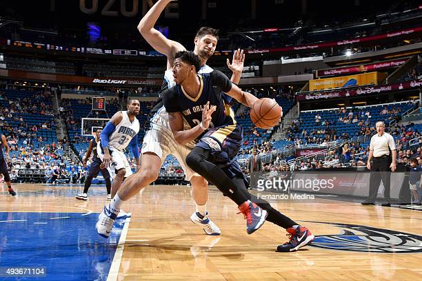 Anthony Davis of the New Orleans Pelicans handles the ball against the Orlando Magic during a preseason game on October 21 2015 at Amway Center in...